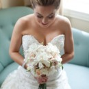 130x130 sq 1415899428197 bride looking fown at bouquet