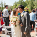 130x130 sq 1415899996027 couples kiss with bouquet