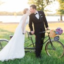 130x130 sq 1432567523677 couples kiss with bike and bouquet