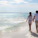 130x130 sq 1454608354143 weddings by funjet concierge couple walking beach