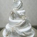 130x130 sq 1392396530542 romatic crystal fondant draped wedding cake 00