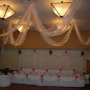 130x130 sq 1366813454514 2 tiered head table  swagging