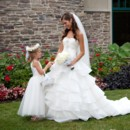 130x130 sq 1366818528594 imgbride and flower girl in front of the building