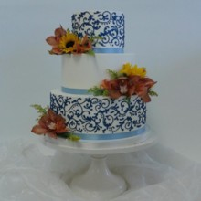 220x220 sq 1468425502092 3 tier white buttercream blue ribbon blue piped sw