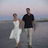 48x48 sq 1466781131 ddc2e2e256989be0 gary   sharon just married walking on the beach at sunset