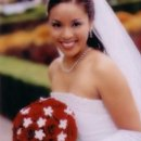 Asian bride with tiara & burgundy bouquet.