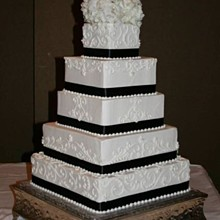 220x220 sq 1264722908422 blackstripescrollscakesparksweddingcopy