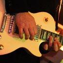 130x130 sq 1359842028377 guitar