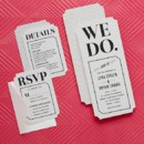 We Do Wed Wedding Invitation in Black Shown with Response and Enclosure Card Designed by: Chewing the Cud for Wedding Paper Divas
