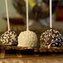 Our delicious brownie pops are a decadent favor indulgence for both you and your guests. Each brownie is handmade with a brownie center, lovingly coated with delicious chocolate (in white, milk or dark) and then adorned with intricate filigree scroll patterns.