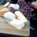 130x130 sq 1361302649505 importedcheeseboardwgrapes