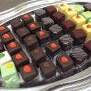 130x130 sq 1401571504532 assorted pass petit fours