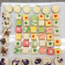 130x130 sq 1401571517023 assorted petit fours and mini blueberry cheese cak