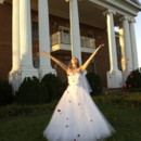 130x130 sq 1395704932809 bride throwing flowers in the air at r
