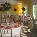 130x130 sq 1395885332049 grand ballroom with white tables and red flower