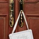 130x130 sq 1478708574435 frontd door with wedding sign