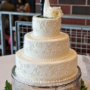 Filagree on each tier of this classic wedding cake