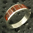 Unique handmade sterling silver man's band inlaid with dinosaur bone by artisan Mark Hileman. The band measures 8mm wide and is a size 10 1/4. The ring is inlaid with 2 different kinds of gem dinosaur bone- red-orange with black matrix and reddish brown with grey matrix. This Utah dinosaur gem bone came from the Colorado Plateau and was a living animal during the Jurassic Period around 144 to 208 million years ago.
