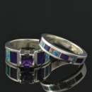 Amethyst engagement ring inlaid with purple sugilite and lab created opal in sterling silver. The center stone is a .65 carat princess cut amethyst. The wedding band is inlaid with lab opal and sugililte to match. This set is available in other inlay materials and with other center stone choices. This wedding set will be made to order in your ring size in 3 to 6 weeks.