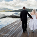 Bride and Groom strolling on Adirondack Dock