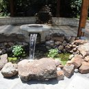 130x130 sq 1301585291442 waterfeaturesfirepitunderarborsjune2010