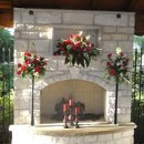 130x130 sq 1321319805366 fireplacewithflowers