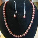 Copper pearls with Swarovski crystal accents and delicate chain dangle earrings on posts.