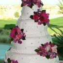130x130_sq_1295302270270-weddingcake4tierflowers