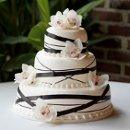 130x130_sq_1326143838934-weddingcakeblackribbonwhite