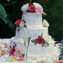 130x130_sq_1326143852261-weddingcakemoderndesignredflowers