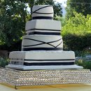 130x130_sq_1326143863686-weddingcakeroundsquareblackribbon