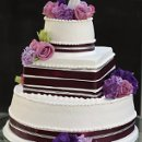 130x130_sq_1326143866558-weddingcakeroundsquarebrownribbon