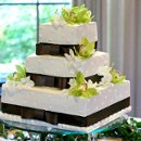 130x130_sq_1326143900276-squareweddingcakebrownribbongreenflowers