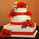 130x130_sq_1326143901957-weddingcakeorangeribbonflowerssquareround