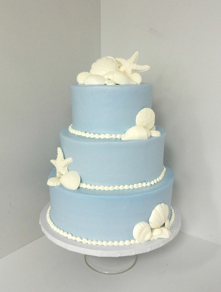 1478710935166 Blue With Seashells Danvers wedding cake