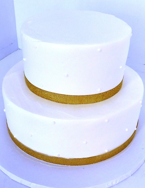 1478715820162 White 2 Tier Gold Bow Danvers wedding cake