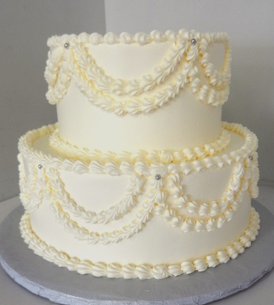 1478715838275 White Ruffle 2 Tier Danvers wedding cake