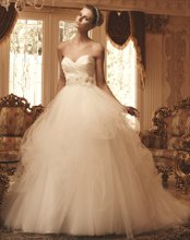 Style: 2103 Soft Tulle pick-ups over satin with a ruched sweetheart bodice. The natural waist is accented by a beautiful beaded and embroidered sash with 3-dimensional organza flowers.