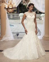 "Style: 2110 Beaded lace appliqués sewn on tulle over Silky Satin. The bateau front neckline is built up with cap sleeves for sheer coverage. The sheer beaded lace continues to a low ""V"" tank back."