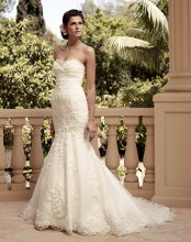 Style: 2115 Crystal Tafetta ruched bodice with sheer beaded trim accent the front and back neckline. Slim trumpet silhouette with beaded lace and scalloped hemline. Crystal buttons finish the tafetta bodice.
