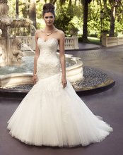 Style: 2116 Embroidered lace gown with silver embroidery accents. Strapless sweetheart neckline and a full asymmetrical trumpet skirt.