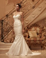Style: 2118 Ruched, stretch Perfecting Satin sweetheart neckline. Front and back bodice is accented with a Swarovski Crystal, pearl, and rhinestone beaded appliqué. Matching fabric covered buttons with loops line the zipper of this mermaid shaped gown.