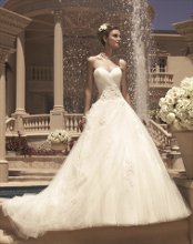 Style: 2112 The ruched sweetheart bodice is accented with beaded Shimmery Lace appliqués. Draped tulle gives the illusion of a split skirt. Beaded lace appliqués are scattered throughout the full A-line skirt.