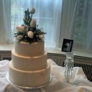 130x130 sq 1351635390170 480weddingcake3tierwhite