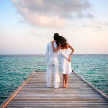 220x220 sq 1527904345 6f5bce66eb6e1e64 couple.on.jetty.looking.at.water