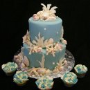 130x130 sq 1194902235359 coralandshellswithruffledcupcakes