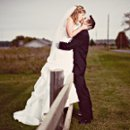 130x130 sq 1258243677608 weddingbridegroomkissingfence