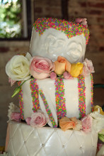 220x220 1445612253683 laurel wedding cake faces