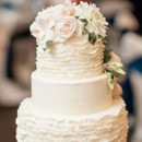 130x130 sq 1490195198554 tiered cake with ruffles and smooth alternating