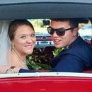130x130 sq 1532627935 5f6675e4264c2147 amber and brent in car 2